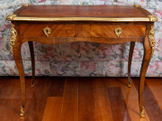 Sale 8677B - Lot 666 - A French Louis style writing desk with leather top over two drawers with cabriole legs, H x 75cm, W x 100cm,, D x 55cm