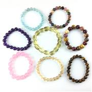 Sale 8758 - Lot 329 - Assorted Gemstone Bangles including Rose Quartz, Amethyst, Tigers Eye, etc - all with display boxes (8)