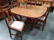 Sale 8848 - Lot 1009 - Early 20th Century French Oak Dining Setting, incl. extension dining table with receding legs joined by stretchers & further folding...