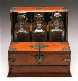 Sale 9122 - Lot 63 - An Oak Compartmental Tantalus With Three Decanters And Hidden Drawer (H: 31 x W:33 D: 26cm)