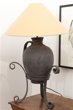 Sale 9191H - Lot 95 - Terracotta Table lamp on scrolled iron base, H 80 cm