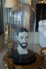 Sale 7984 - Lot 80 - Early 19th century carved timber priests head in Victorian glass dome.