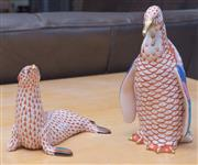 Sale 8593A - Lot 35 - Two Herend figures of a penguin, H 17cm, and a walrus