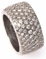 Sale 8937 - Lot 451 - AN 18CT WHITE GOLD HALF HOOP DIAMOND RING; 10.26mm wide shank pave set with 7 rows of round brilliant cut diamonds, 127 diamonds tot...