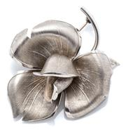 Sale 9046 - Lot 587 - A VINTAGE SILVER ROSE BROOCH; textured petals, stem stamped DJ with London import marks for 1968, size 42 x 60mm, wt. 12.66g.