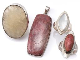Sale 9124 - Lot 577 - THREE SILVER STONE SET COCKTAIL RINGS AND PENDANT; rings set with oval cut ornamental (top 39 x 29), oval coral (33 x14mm), navette...