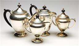 Sale 9238 - Lot 28 - An etched and timber handled four piece triple plate tea service (H:21cm to 17cm)