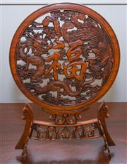 Sale 8308A - Lot 62 - A Chinese red wood carved table screen with stand, pierced dragons, waves and Chinese character design,  H 43cm