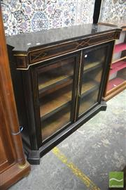 Sale 8335 - Lot 1056 - 19th Century Ebonised & Inlaid Side Cabinet, with gilt metal mounts & two glass panel doors, enclosing velvet lined shelves (Key in...