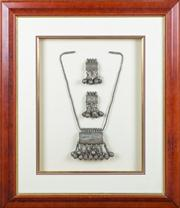Sale 8470H - Lot 303 - A framed Bedouin necklace and earring set, 73 x 61cm