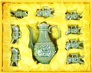 Sale 8968 - Lot 83 - Boxed Chinese celadon suite of eight small and one medium  sized jugs