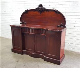 Sale 9126 - Lot 1123 - Victorian Mahogany Sideboard, with carved back, the central serpentine section with a drawer & two panel doors, flanked by taller ar...