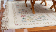 Sale 8677B - Lot 670 - A woollen carpet with  repeating floral pattern on a cream ground 276 x 370cm