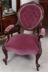 Sale 8963H - Lot 67 - A late Victorian carved walnut gentlemans armchair upholstered in a plum buttoned velvet