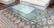 Sale 8990H - Lot 11 - An overized glasstop coffee table of rectangular form raised on a pair of concrete planter bases, Height 43cm, Width of glass 119cm...