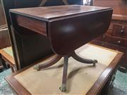 Sale 9068 - Lot 1034 - Regency Mahogany Pembroke Table, with reeded edge & drop-leaves, fitted with a frieze drawer & raise don a turned pedestal with outs...
