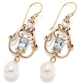 Sale 9164J - Lot 361 - A PAIR OF NOUVEAU STYLE AQUAMARINE AND PEARL EARRINGS; scrolling 9ct gold frames each set with an oval cut aquamarine suspending a f...