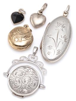 Sale 9156J - Lot 541 - A GROUP OF SILVER LOCKETS AND PENDANTS; a spinning fob locket (wont close), 35 x 27mm, a long oval shape flower engraved locket, 40...