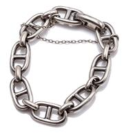 Sale 9095 - Lot 320 - A STERLING SILVER BRACELET; 19 x 11.10mm anchor links united by oval jump rings to a folding clasp with safety chain, length 19cm, w...