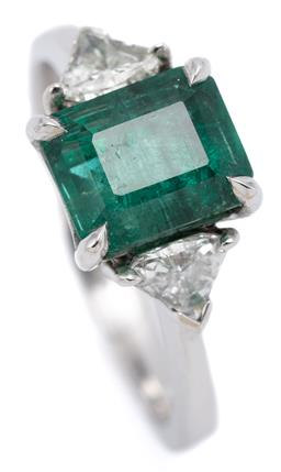Sale 9149 - Lot 422 - AN 18CT WHITE GOLD EMERALD AND DIAMOND RING; 4 claw set with an emerald cut emerald of approx. 2.73ct to shoulders each set with a m...