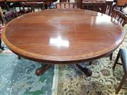 Sale 8792 - Lot 1066 - 19th century style mahogany dining table with a cross-banded edge above a carved birdcage base with central finial, H 75 x diameter...