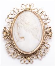 Sale 8980J - Lot 55 - An antique 9ct rose gold and hand cut shell cameo brooch C: 1890s, the beautifully hand cut shell portrait cameo within a rub over ...