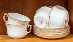 Sale 9120H - Lot 184 - A set of six Hammersley & Co cups and saucers in white with gilt borders.