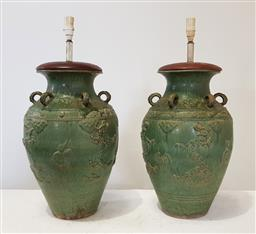 Sale 9196 - Lot 1029 - Pair of Tall Chinese Martaban Style Table Lamps, in green glaze with dragons in relief & loop handles (h:77 x d:40cm)