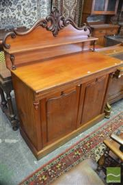 Sale 8335 - Lot 1067 - Late 19th Century Cedar Chiffonier, carved back with shelf, above a freeze drawer and 2 shield panel doors with acorns