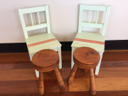 Sale 8677B - Lot 678 - A pair of rustic pine milking chairs together with two green painted childrens chairs.