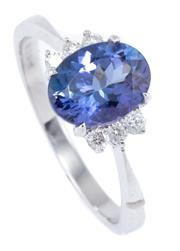 Sale 8937 - Lot 400 - A TANZANITE AND DIAMOND RING; set in 10ct white gold with an oval cut tanzanite of 1.38ct to 6 round brilliant cut shoulder diamonds...
