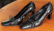 Sale 9044H - Lot 36 - A pair of Emporio Armani black patent leather block toe shoes, size 37