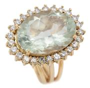 Sale 9083 - Lot 527 - AN 18CT GOLD DIAMOND AND STONE SET COCKTAIL RING; centring an oval cut green quartz of approx. 11ct to a surround of 25 round brilli...