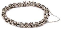Sale 9124 - Lot 572 - A SILVER BYZANTIAN LINK BRACELET; 9mm wide plain and wire twist links to box clasp with safety chain, length 20.5cm, wt. 42.55g.