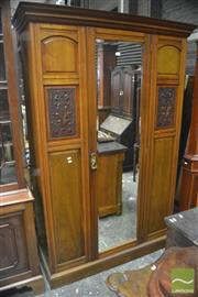 Sale 8335 - Lot 1014 - Late Victorian Walnut Wardrobe, with mirror panel door, flanked by carved floral panels