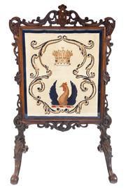 Sale 8530A - Lot 52 - A fine example of a Victorian elaborately carved walnut firescreen, the front revealing a tapestry behind glass of a rooster beneath...