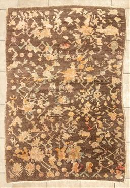 Sale 9130H - Lot 40 - A contemporary Afghani Woollen rug with floral sprays over a tawny ground, 110 x 160cm