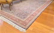 Sale 8470H - Lot 302 - A large Hereke wool carpet with clusters of interlaced flowers on heavily faded blue ground, 345 x 237cm