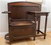 Sale 8644A - Lot 91 - A Jacobean style oak hall seat, with umbrella stand and underseat storage, H 105 x W 118 x D 42cm.
