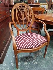 Sale 8728 - Lot 1077 - Set of Three Sheraton Style Possibly Satinwood Armchairs, the ovl backs with Prince-of-Wales design, caned seats with loose striped...