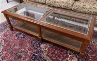 Sale 8963H - Lot 99 - A walnut coffee table with bevelled glass panels and caned shelf Height 37cm x Width 129cm x Depth 53cm