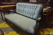 Sale 8255 - Lot 1088 - Victorian Carved Settee, with blue buttoned upholstery & on turned legs