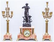 Sale 8287A - Lot 90 - A French rouge marble & bronze clock with matching garnitures set.  49cm high x 28cm wide x 14cm deep garnitures (each) 51cm high...