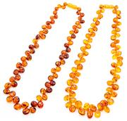 Sale 8905J - Lot 399 - TWO AMBER BEAD NECKLACES; 7-13mm graduated polished reconstituted amber beads to screw clasps, lengths 46cm.