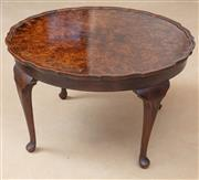 Sale 8908H - Lot 82 - A circular figured walnut art deco period coffee table. C1930 the highly figured and scalloped edge top raised on four slender cabri...