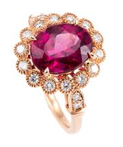 Sale 8974 - Lot 361 - A PINK TOURMALINE AND DIAMOND CLUSTER RING; centring a 2.53ct rubellite to surround and shoulders set with 18 round brilliant cut di...