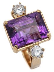 Sale 9046 - Lot 506 - AN 18CT GOLD AMETHYST AND GEMSET COCKTAIL RING; featuring a step cut amethyst of approx. 11.18ct adjacent to 2 round cut white stone...