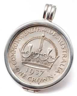 Sale 9124 - Lot 375 - A 1937 CROWN IN PENDANT; Crown mounted in a hinged frame, size 41.4mm, wt. 39.84g.