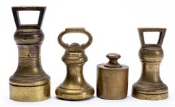 Sale 9130E - Lot 4 - A collection of four brass scale weights, tallest Height 14cm