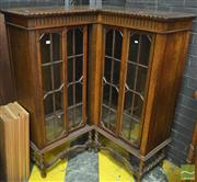Sale 8291 - Lot 1069 - Rare Early 20th Century Oak Corner Bookcase, with four astragal sliding doors, on barley twist legs and stretchers